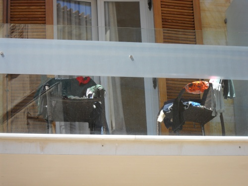 Zack and Emmanuel do a little sink laundry and leave their unmentionables out on the balcony to dry.