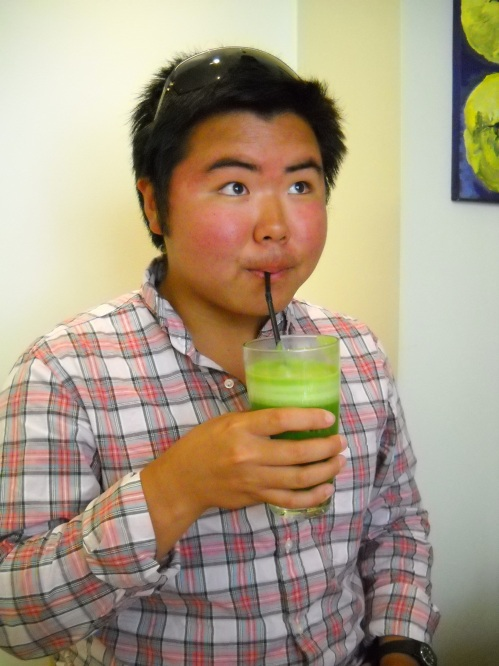 Eman drinking a green shake: could be wheat grass, could be avocado, could be kale, but we will never know for sure.