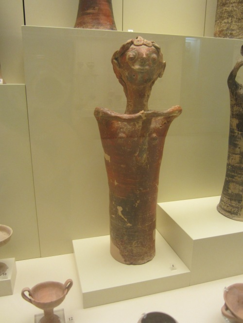 """A terracotta figure of a god probably holding an attribute (Late Helladic IIIB2). The holes on its face and body reveal that hair and clothes were likely attached. """"He's not holding his junk. He is not that proud of his junk.""""-JR"""