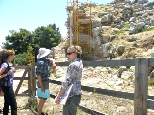 Magister Susanane Prillwitz discusses the restoration efforts on the eastern outer fortification walls of the citadel at Tiryns. Notice the Cyclopean masonry!