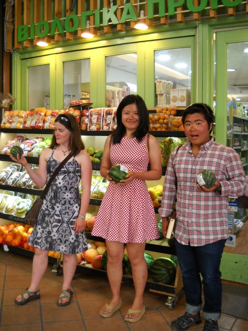 Laurel, Zhenwei and Eman holding up some mini watermelons.