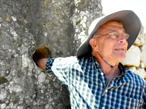 Professor Rutter puts his arm into one of the smooth, drilled holes of the door jamb that marks the first gate into Tiryns. This hole in conjunction with its counterpart on the other side of the door was used to slide in a wooden crossbeam that would have kept the door closed against intruders…for a little while.