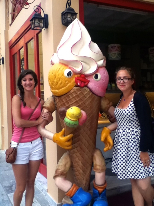 Margo and Nina stand arm-in-arm with the cannibalistic ice cream cone around the corner from our hotel.