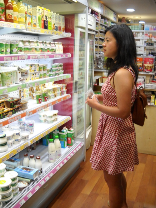 Zhenwei checking out the dairy isle to offset the vegan food she ate minutes before.