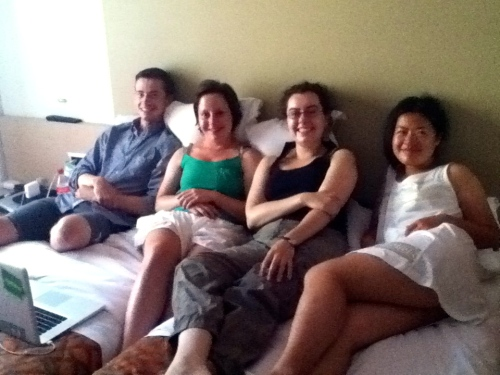 Brett, Cara, Catherine D., and Zhenwei unwind while watching a movie in the afternoon.