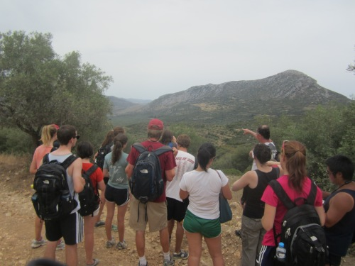 Professor points out the path of the Mycenean road that lead us from Mycenae to Prosymni.