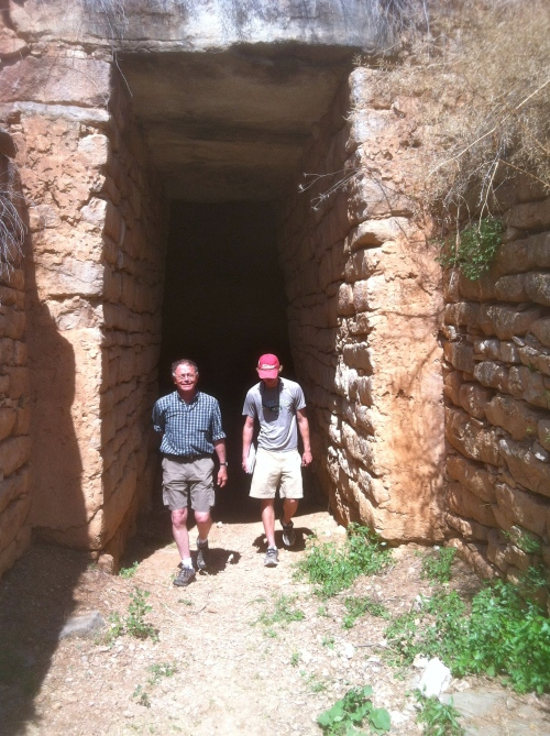 After a thorough examination of the two-leaved doorway to the inner chamber, Professor Rutter and Cam leave the tholos tomb through the stomion (doorway) with more questions than answers.
