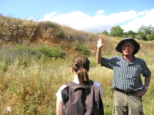 Professor Rutter points out the Cyclopean masonry that faced the large channel that diverted water from the plains surrounding Tiryns and prevented flooding in the area. Presence of such a large architectural project indicate the power of the Mycenaeans who controlled this area of the ancient Argolid. Laurel looks at the construction, awestruck in her imagination.