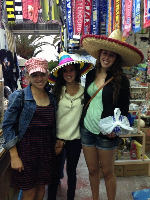 Catherine B., Nina and Laura continue their search for the perfect hat.