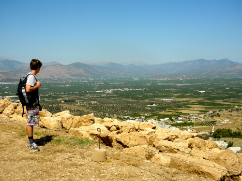 Teddy gazes into the Argive plain, trying to get a sense of how the monarchs of Mycenaean citadels would have dominated the area.