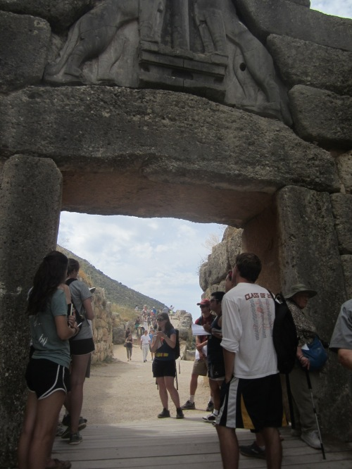 The gang examines the Lion Gate of Mycenae.
