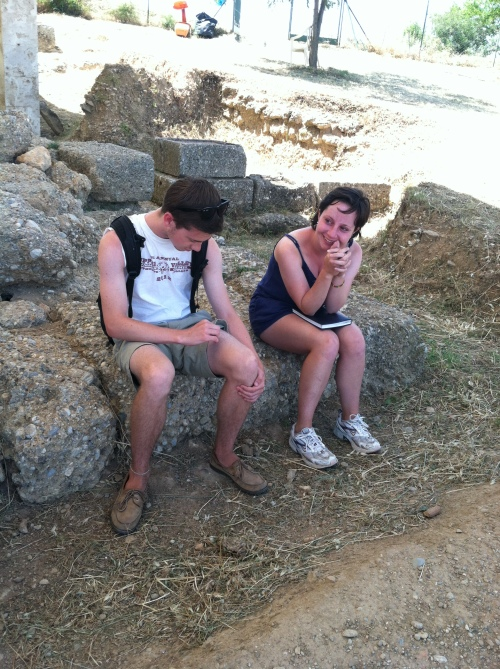 Brett and Cara enjoy the shade while sitting on the remains of the Hellenistic temples at Aigeira.