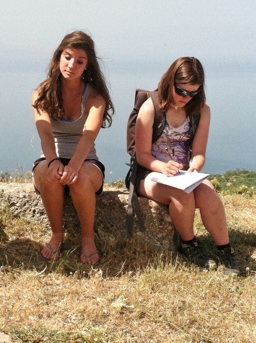 Nina and Laurel listen to Prof. Rutter's lecture on the Aigeira acropolis. On this acropolis, excavators found remains of a late 12th - century B.C. Mycenaean settlement with fortification walls!