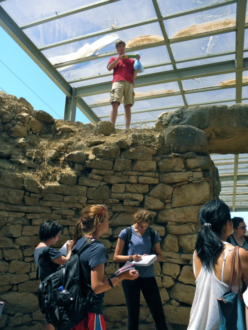 The enormous size of this tholos tomb is obvious in this photo. Zack eats his first lunch high above, and others take note of how the tholos was constructed.