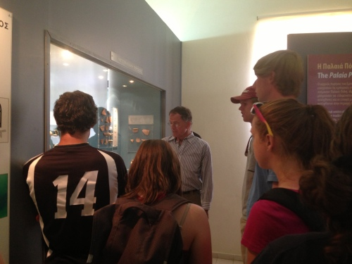 In the museum, Prof. Rutter points out important finds.