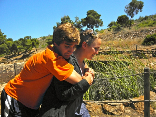 Teddy and Margo sharing a tender moment at Lavrion next to one of the large cisterns, used for cleaning the ore.