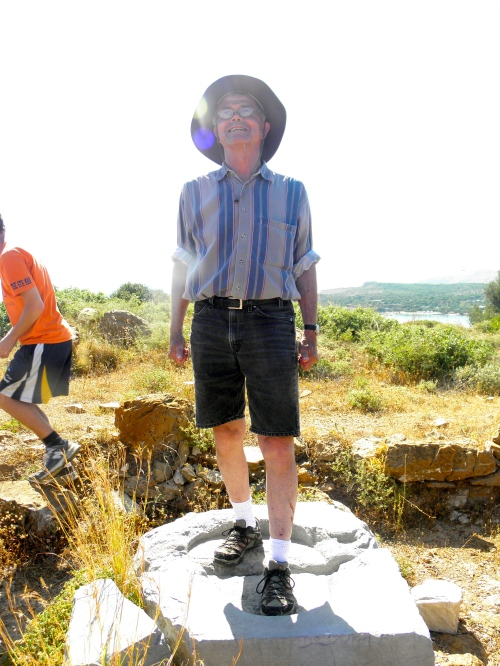 Professor Rutter demonstrating how the stone statue would have stood on this Eleusinian marble base.