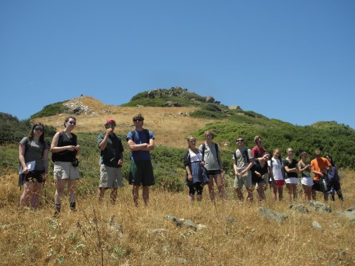 The group waiting as Professor Rutter searches for the round tholos tomb.