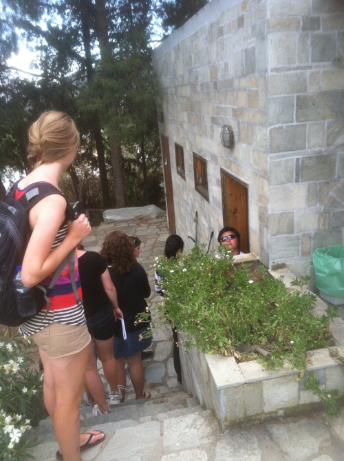 The group anxiously waiting in line at the W.C. at Dimini after a 3-hour bus ride from Thebes to Thessaly.