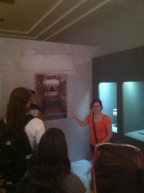 Dr. Rousioti shows us a picture of the façade of an unusual tholos tomb. This tomb had a second lintel block on top of the relieving triangle, making it appear as if it had two stories.
