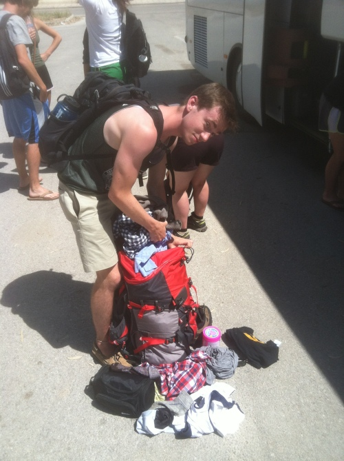 Brett completely unpacks his frame pack to get his bathing suit from the bottom in anticipation of a little swimming time at the beach.