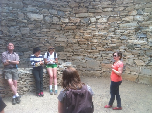 J.R. thoughtfully looks off into the distance while Dr. Rousioti tells us interesting stories about the history of the tholos tomb.